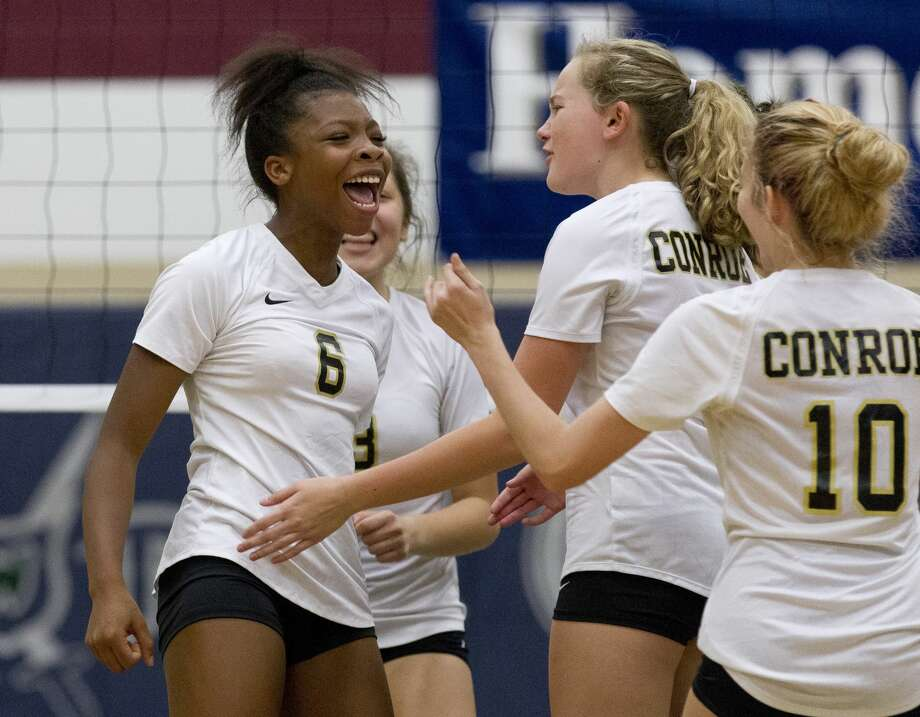 Conroe's T'lisha Kennedy (6) reacts after scoring a point during the first set of a District 15-6A high school volleyball game at College Park High School, Tuesday, Sept. 25, 2018, in The Woodlands. Photo: Jason Fochtman/Staff Photographer