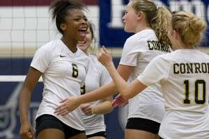 Conroe's T'lisha Kennedy (6) reacts after scoring a point during the first set of a District 15-6A high school volleyball game at College Park High School, Tuesday, Sept. 25, 2018, in The Woodlands.