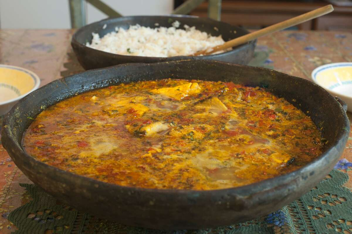 Moqueca Bahia is a Brazilian seafood stew flavored with palm oil.