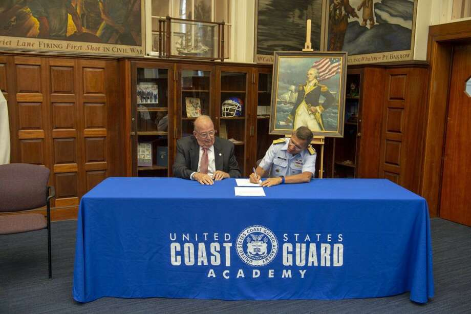 Coast Guard Academy Superintendent Rear Adm. James E. Rendon and Peter Melera, president of the Sponsored Projects Research Incorporated Board of Directors, sign the agreement establishing the grants office during a ceremony Sept. 10. Photo: Photo By Petty Officer 2nd Class Lauren Laughlin