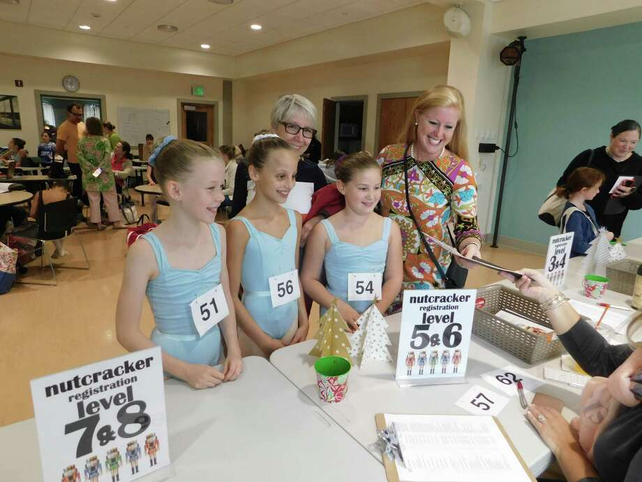 """Kim Shanks, left rear, and Ashley LaBonte, both of Litchfield, help Kim's daughter Jemima (No. 51), friend Lillian Perkel (No. 56), and Ashley's daughter Addison (No. 54) register to audition for """"The Nutcracker"""" Sept. 22 at the Nutmeg Conservatory for the Arts. Photo: Jack Sheedy / Contributed Photo"""