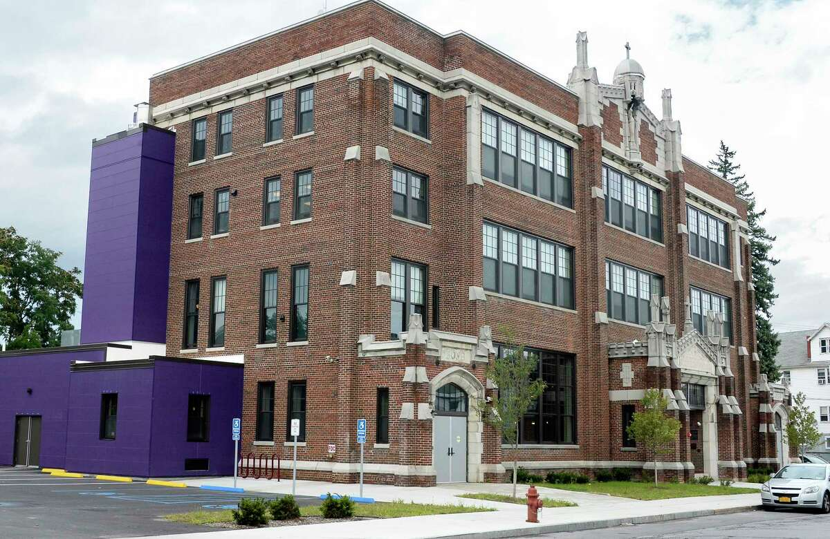 Erected as St. Columba's School and formerly a Boys and Girls Club, this is now the Electric City Barn, a newly purposed building with makerspace and community meeting rooms on the ground floor and apartments on the top floors on Craig Street Wednesday Sept. 26, 2018 in Schenectady, NY.(John Carl D'Annibale/Times Union)