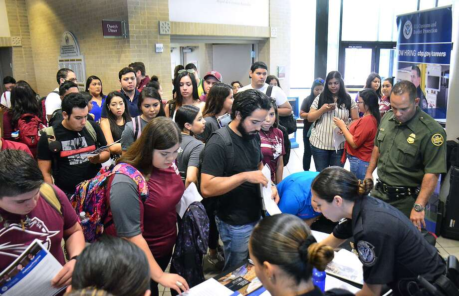 TAMIU students speak with CBP recruiters about the CBP Officer Student Trainee Internship Program on Tuesday at the TAMIU Student Center. Photo: Cuate Santos / Laredo Morning Times / Laredo Morning Times