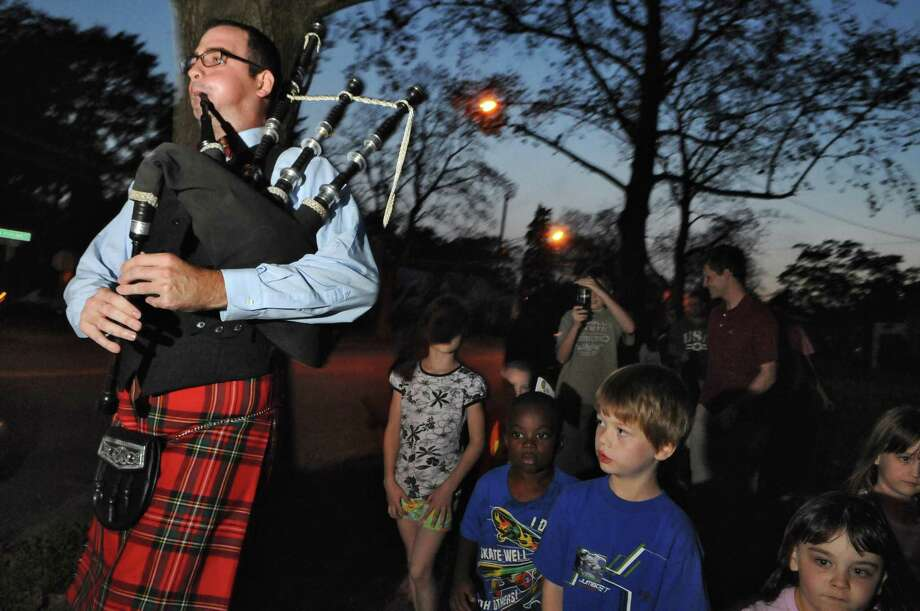 Albany no longer has a Columbus Day parade. Click through the photos of Capital Region Columbus Day celebrations through the years.  Daniel Cole, Musical Director for the City of Albany Pipe Band, plays bagpipes while leading children and their families on a Columbus Day Children's Parade on New Scotland Avenue on Monday evening Oct. 10, 2011 in Albany, NY.  Cole spoke with the children about the history of the bagpipe, and demonstrated it for them at the Bach Library prior to the march around the block. Some children carried flags they had made during the after school craft time on Wednesdays at the Albany Public Library branch. ( Philip Kamrass / Times Union) Photo: Philip Kamrass, Albany Times Union / 00014895A