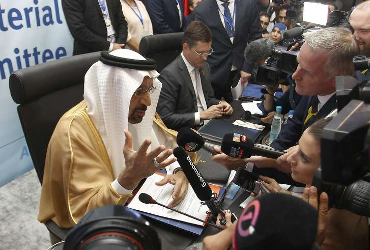 Khalid Al-Falih, Minister of Energy, Industry and Mineral Resources of Saudi Arabia speaks to journalists during OPEC's 10th meeting of the Joint Ministerial Committee to monitor the oil production reduction agreement of the Organization of the Petroleum Exporting Countries, OPEC, and non-OPEC members, in Algiers, Algeria, Sunday, Sept. 23, 2018. (AP Photo/Anis Belghoul)