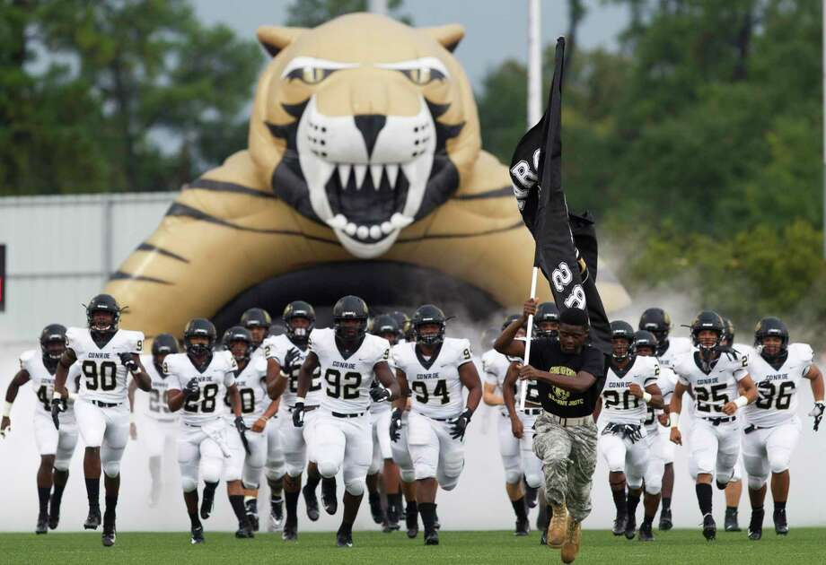 Conroe football players take the field before a District 15-6A game at Klein Memorial Stadium on Saturday, Sept. 22, 2018, in Spring. Photo: Jason Fochtman, Houston Chronicle / Staff Photographer / © 2018 Houston Chronicle
