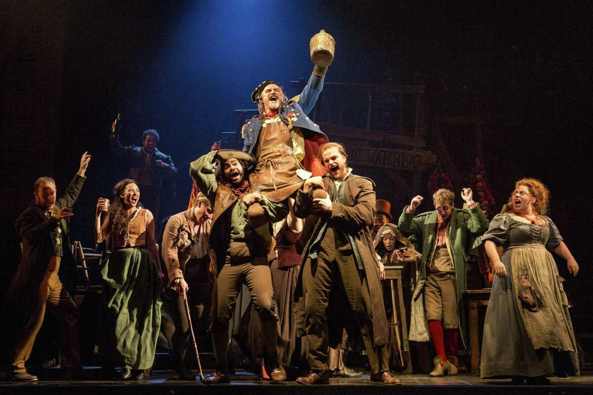 """The company of """"Les Misérables"""" performs """"Master of the House"""" with J. Anthony Crane as Thénardier and Allison Guinn as Madame Thénardier."""