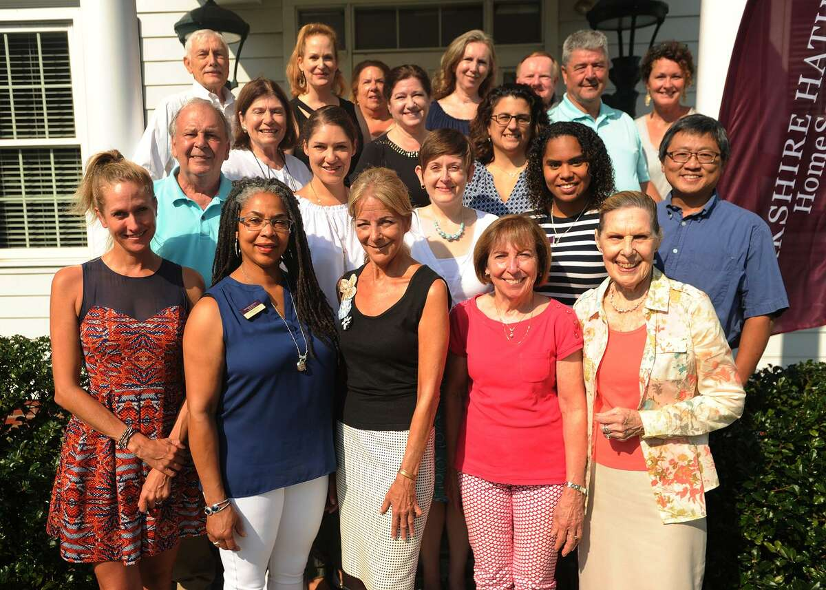 The Berkshire Hathaway HomeServices team outside their offices at 124 East Ave., Norwalk.