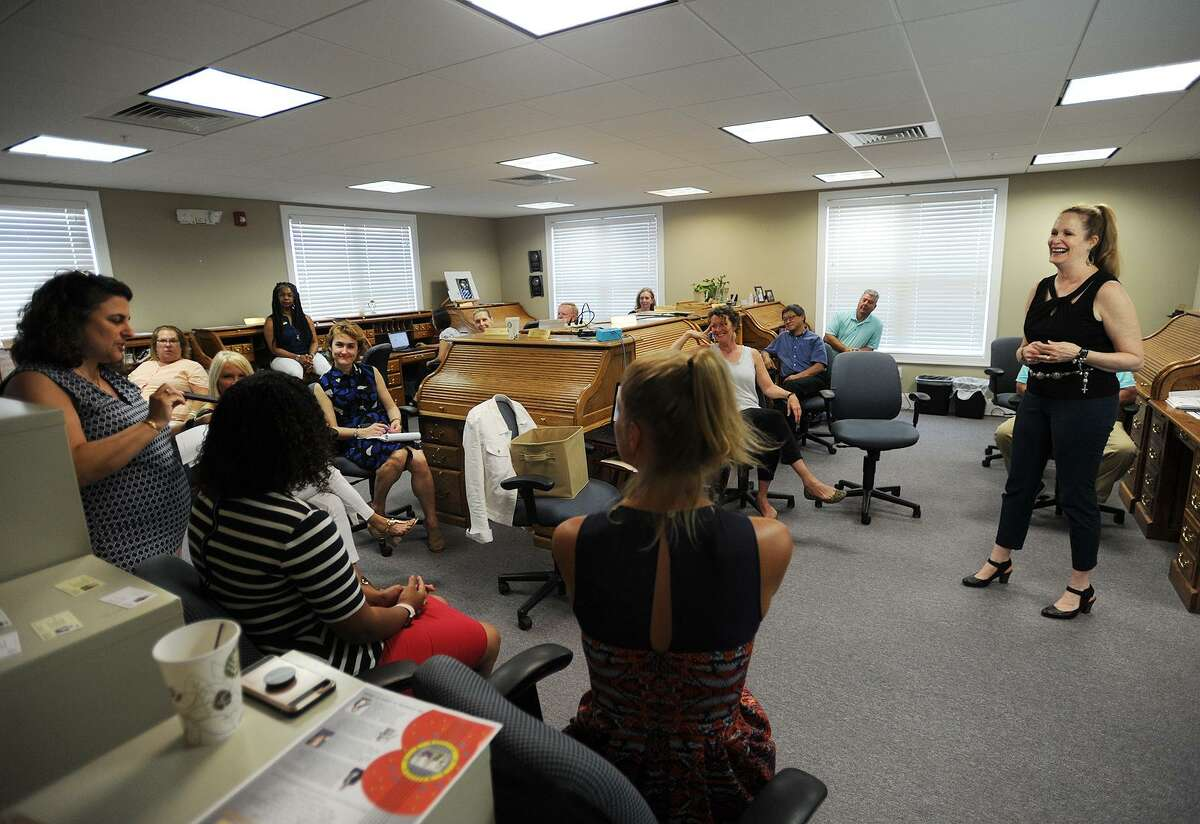 Manager Nancy Pantoliano, right, leads the bimonthly staff meeting on Sept. 6.