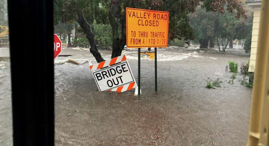 Rooster River flooded its banks during Tuesday's torrential storm. Photo: Contributed Photo / Fairfield Citizen