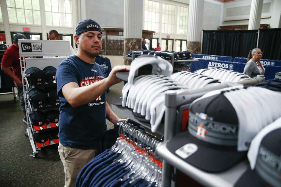 Houston Astros fan Saul Osorio shops for Postseason gear in the Team Store at Minute Maid Park after the Astros clinched the AL West Division and a spot in the playoffs Wednesday in Houston. Photo: Michael Ciaglo, Houston Chronicle / Staff Photographer / Michael Ciaglo