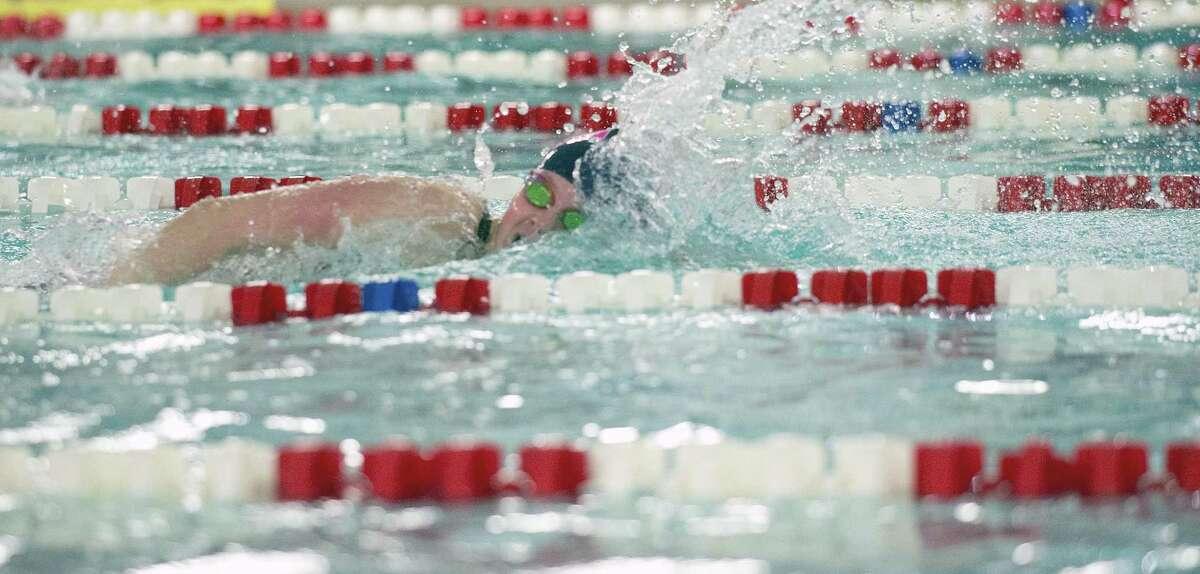 Esme Hunter wins the 100 freestyle during the FCIAC championship swim meet on Nov. 4.