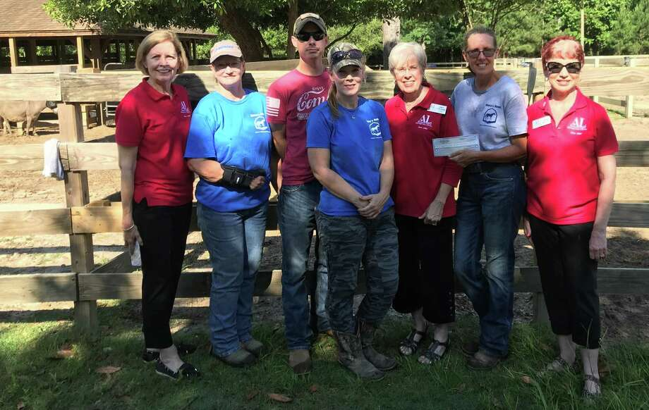 The Assistance League of Montgomery County presented a donation given to scholarship veterans in the Horses & Heroes Equine Program at Henry's Home Horse and Human Sanctuary in Conroe. Photo: Submitted Photo / Submitted Photo