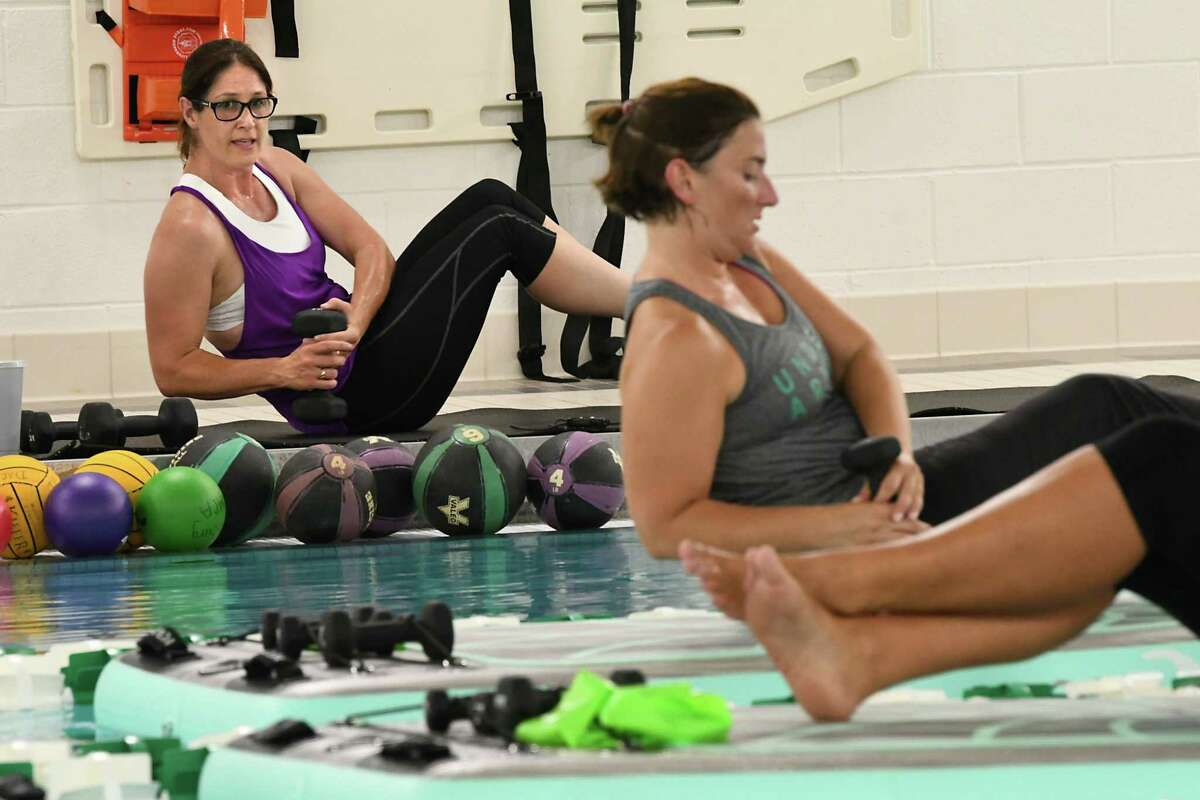 Jen Dickson, left, teaches a BOGA Fit class at the pool in the Duanesburg YMCA on Tuesday, Aug. 28, 2018 in Delanson, N.Y. (Lori Van Buren/Times Union)