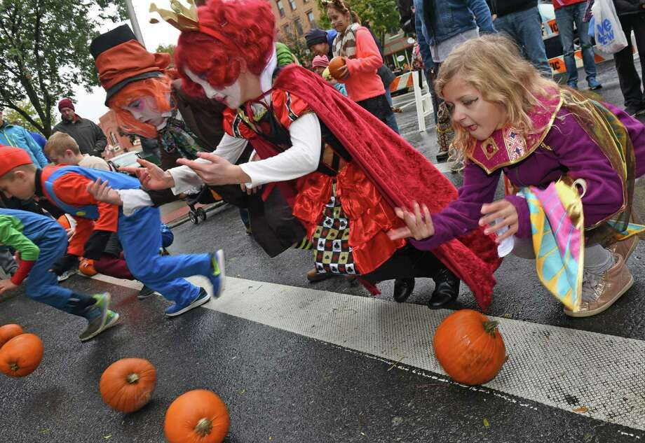 FILE — Costumed children participate in the pumpkin roll down Caroline Street during the Saratoga Springs Downtown Business Associationthe 15th Annual Fall Festival on Saturday Oct. 29, 2016 in Satatoga Springs, N.Y.  (Michael P. Farrell/Times Union) Photo: Michael P. Farrell / 20038600A