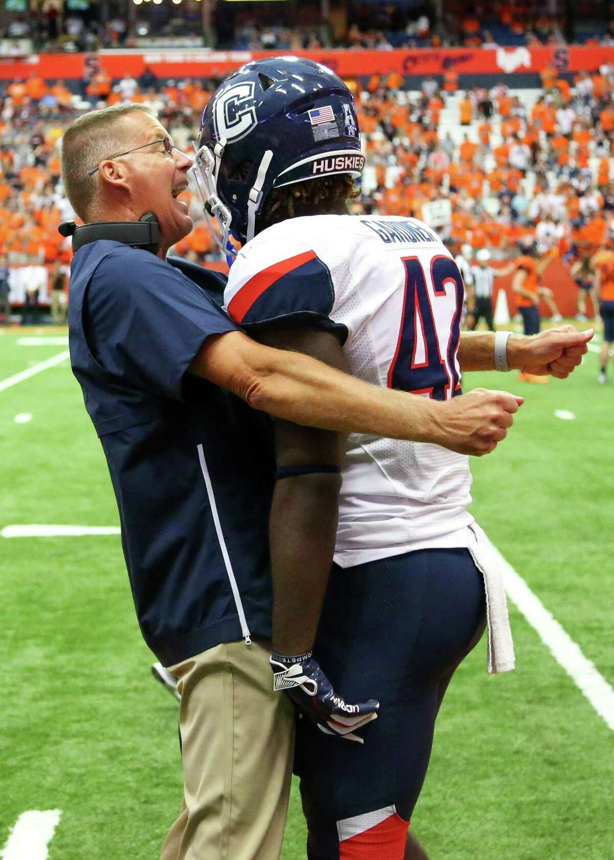 UConn coach Randy Edsall reacts to a missed tackle with player T.J. Gardner following a special teams touchdown by the Syracuse Orange during the third quarter on Sept. 22.