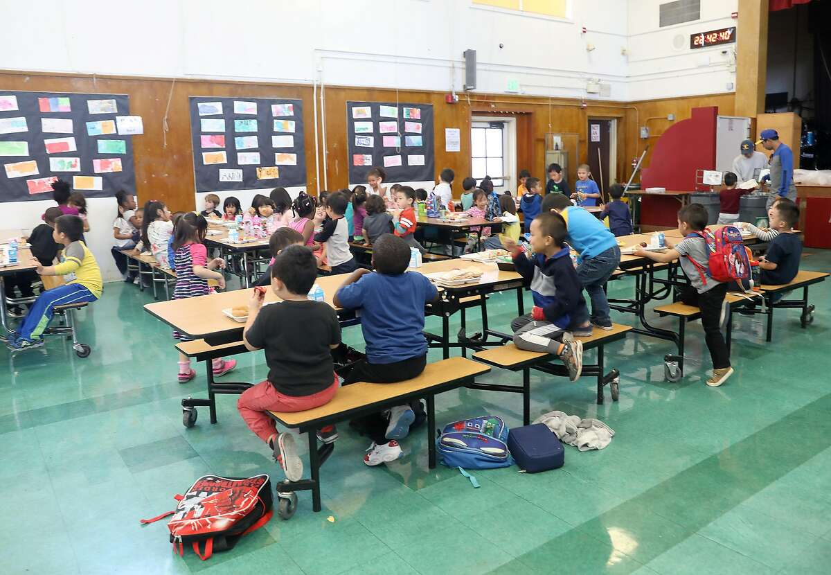 Kindergarten students have lunch in the cafeteria at Franklin Elementary school on Friday, Sept. 7, 2018, in Oakland, Calif. The after school supper program at Franklin Elementary school has been cut.