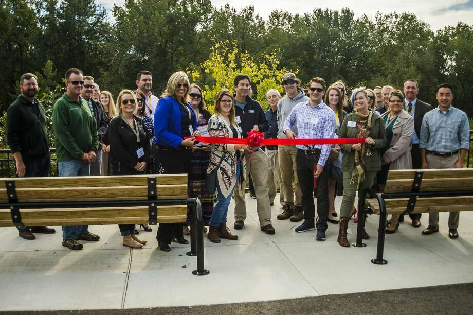 Staff of Little Forks Conservancy and members of the Midland Area Chamber of Commerce pose for a photo during a ribbon cutting ceremony for Little Forks' Averill Preserve on Wednesday, Sept. 26, 2018 in Averill. (Katy Kildee/kkildee@mdn.net) Photo: (Katy Kildee/kkildee@mdn.net)