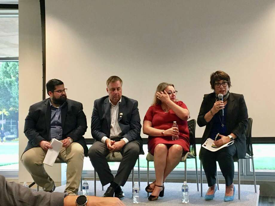 From left, Steven Hussain, Craig Hopkins, Jo Ana Alvarado and Jordana Barton speak on a panel at the University of Texas at San Antonio's downtown campus Tuesday, Sept. 25, 2018. Photo: Madison Iszler /Express-News