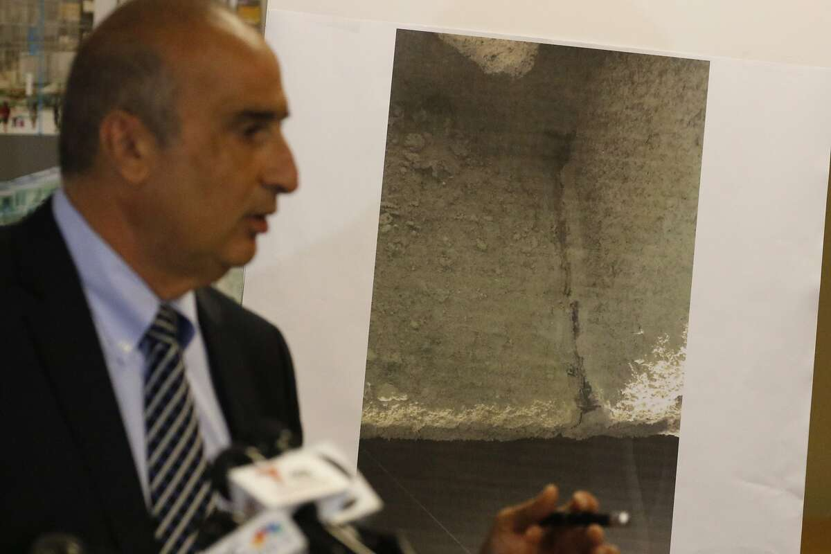 """Mark Zabaneh, Executive Director of the Transbay Joint Powers Authority shows one of the two beams that are cracked on the lower flange of the I beam with 2.5"""" cracks over Fremont St. on Wednesday, Sept. 26, 2018, in San Francisco, CA."""