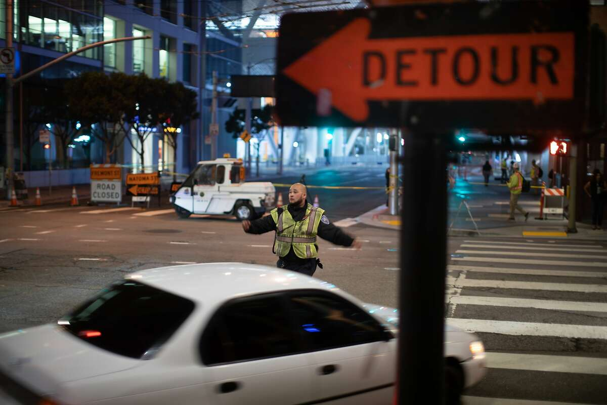 Jay Fernandez directs traffic at Fremont and Howard Streets on Wednesday, Sept. 26, 2018, in San Francisco, Calif.