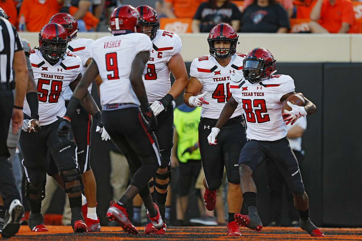 STILLWATER, OK - SEPTEMBER 22: Wide receiver KeSean Carter #82 of the Texas Tech Red Raiders celebrates a touchdown against the Oklahoma State Cowboys in the second quarter on September 22, 2018 at Boone Pickens Stadium in Stillwater, Oklahoma. (Photo by Brian Bahr/Getty Images)