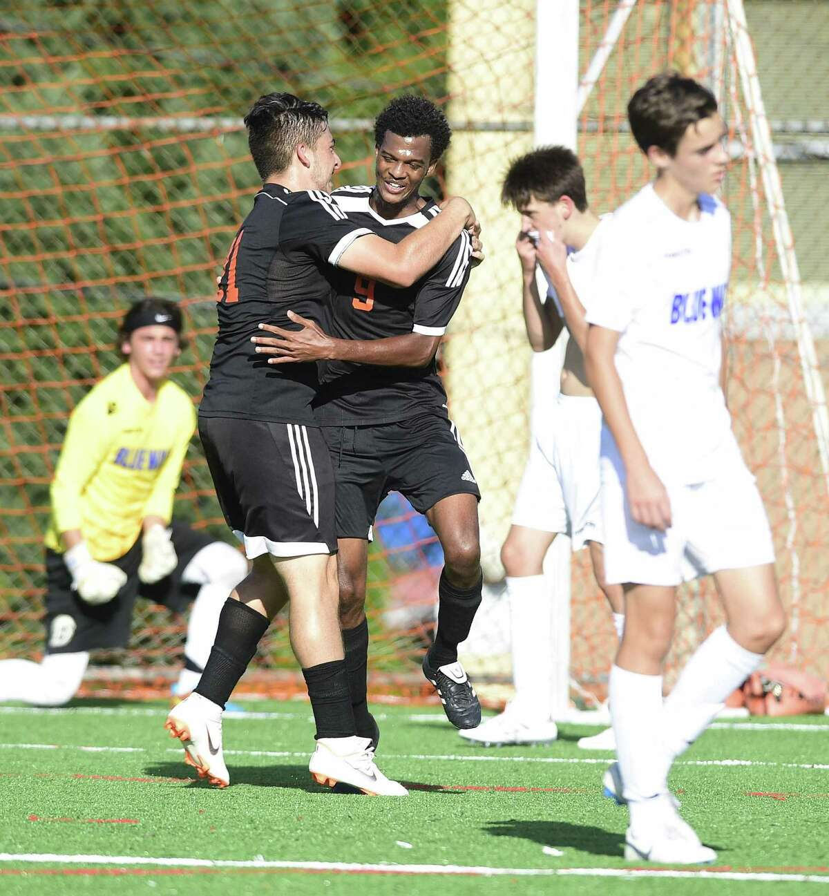 Stamford's Kenly Lalanne (9) center celebrates his goal against Darien during the first half of an FCIAC boys soccer game on Wednesday, Sept. 26, 2018 in Stamford, Connecticut.