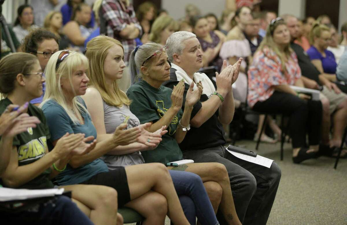 Members of the public attend the Santa Fe ISD trustees meeting Monday, July 16, 2018, in Santa Fe. The board voted to install metal detectors in each of the district's schools.