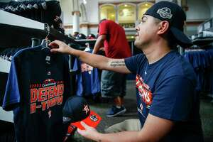 Houston Astros fan Saul Osorio shops for Postseason gear in the Team Store at Minute Maid Park after the Astros clinched the AL West Division and a spot in the playoffs Wednesday Sept. 26, 2018 in Houston.