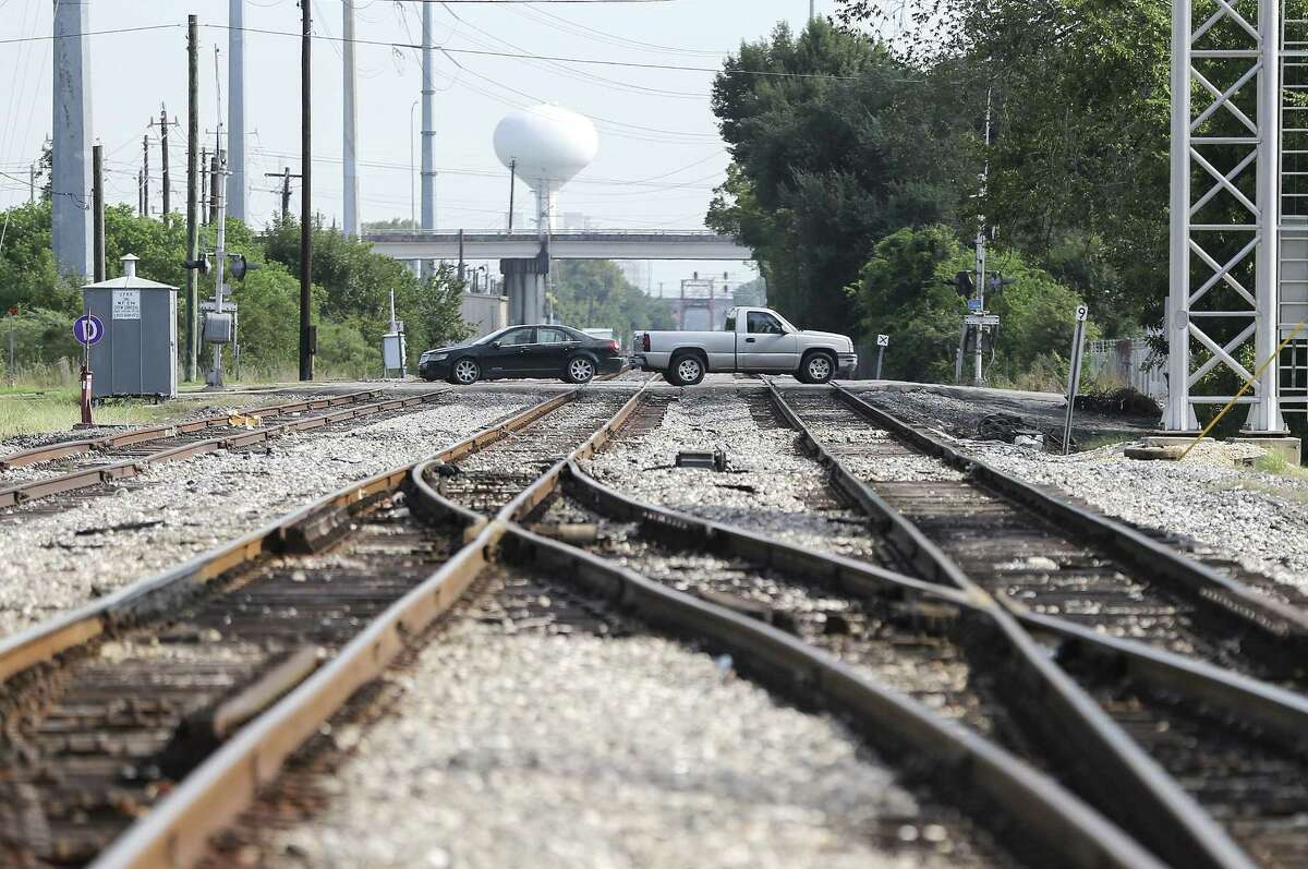 Cars cross over train tracks on Canal Street in Houston's East End on Wednesday, Sept. 26, 2018 in Houston.