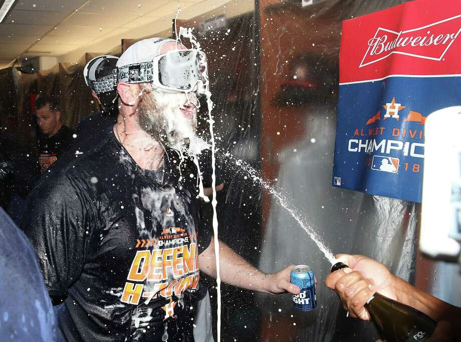 PHOTOS: A look inside the Astros' clubhouse celebration after they clinched the AL West TORONTO, ON - SEPTEMBER 26: Brian McCann #16 of the Houston Astros celebrates in the clubhouse after the Astros clinched the American League West division title after their MLB game against the Toronto Blue Jays at Rogers Centre on September 26, 2018 in Toronto, Canada. For a look inside the Astros clubhouse during their celebration on Wednesday ... Photo: Tom Szczerbowski, Getty Images / 2018 Getty Images