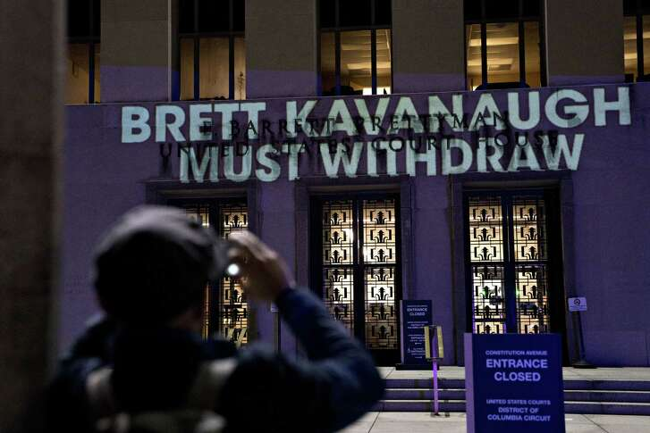"The words ""Brett Kavanaugh Must Withdraw"" were projected by demonstrators onto the E. Barrett Prettyman Courthouse in Washington, D.C., on Tuesday, Sept. 25, 2018."