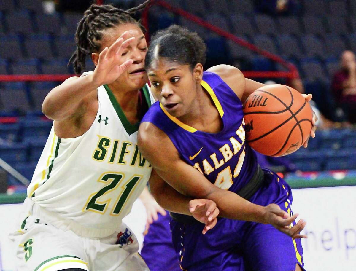 Siena's #21 Kollyns Scarbrough,left, tangles with UAlbany's #44 Chyanna Canada during their Albany Cup game at the Times Union Center Saturday Dec. 9, 2017 in Albany, NY. (John Carl D'Annibale / Times Union)