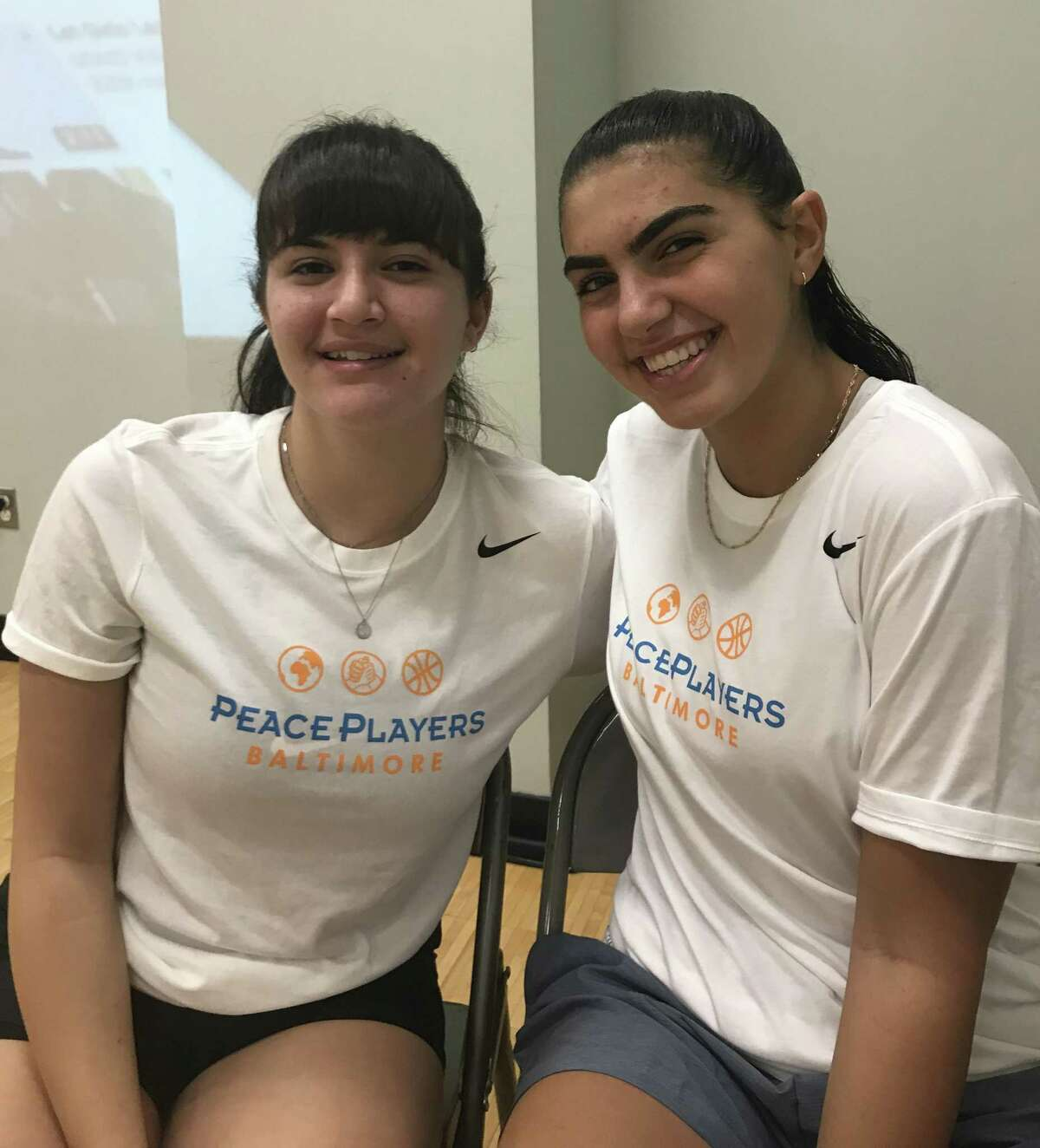 Peace players Jenan Maharmeh, 17, left, and Noga Tal, 15, both of Jerusalem, played against St. Luke's in a goodwill game on Sept. 26 in New Canaan.