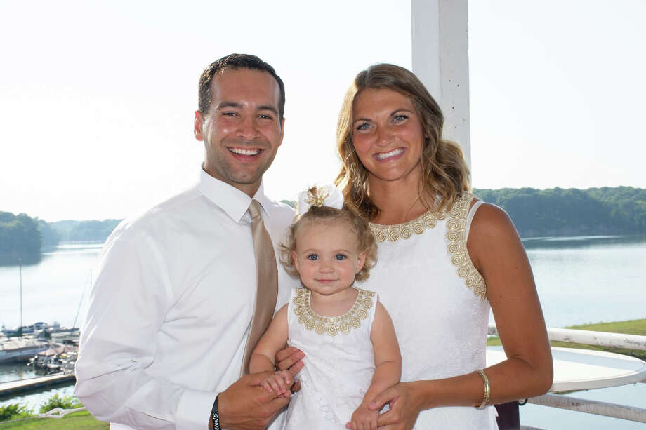 Lindsey (Dulude) Grillo poses with her husband Andrew and their daughter Addison. Photo: Photo Provided