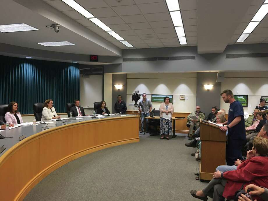 Dr. Matthew Pike, owner of Aqueduct Animal Hospital, speaks before the Niskayuna Town Board about a proposed change to make the town's barking law stricter that he said threatens his business on a public hearing at Niskayuna Town Hall on Tuesday, September 25, 2018.