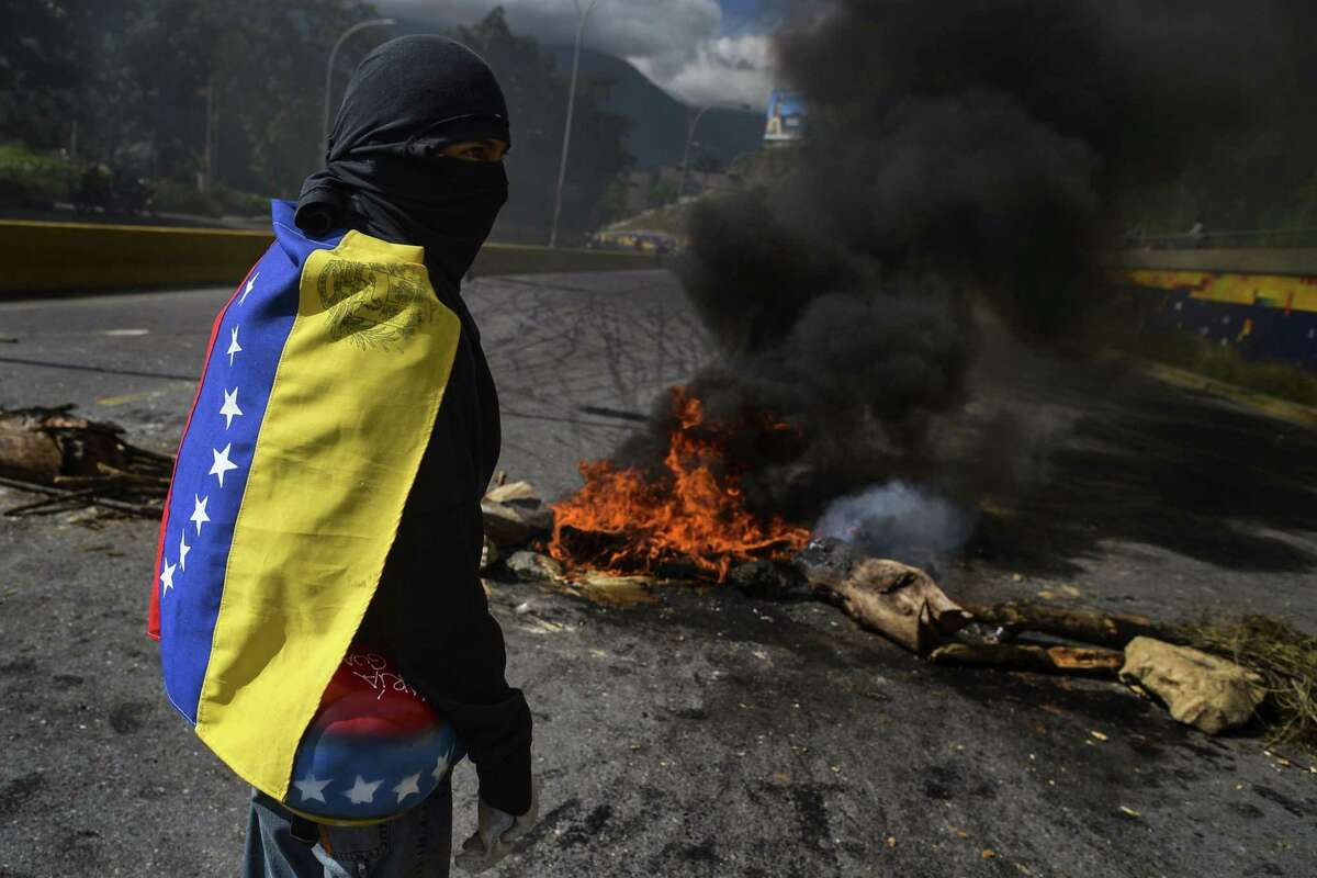 Anti-government demonstrators mount a roadblock during a protest against Venezuelan President Nicolas Maduro in Caracas in 2017.