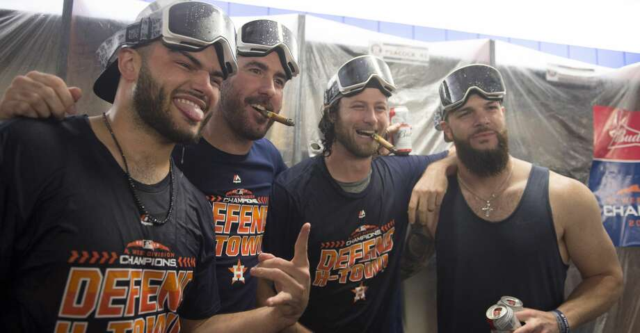 Houston Astros' Lance McCullers Jr, left to right, Justin Verlander, Gerrit Cole and Dallas Keuchel celebrate in the locker room after a baseball game against the Toronto Blue Jays, Wednesday, Sept. 26, 2018 in Toronto. The World Series champion Astros clinched another AL West title when Oakland lost in extra innings late Tuesday night. (Frank Gunn/The Canadian Press via AP) Photo: Frank Gunn/Associated Press