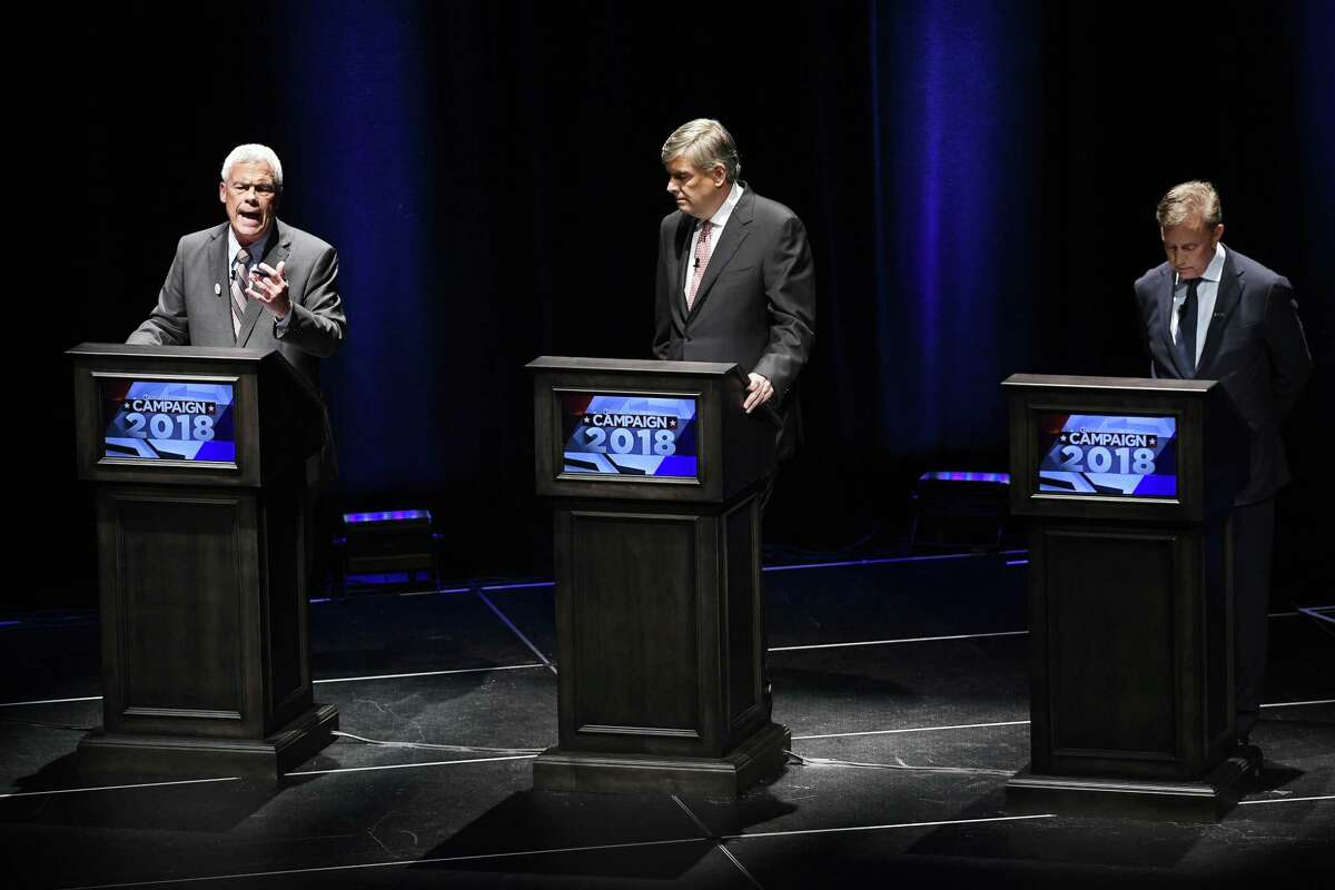 Independent candidate Oz Griebel, left, speaks as Republican candidate Bob Stefanowski, center, and Democratic candidate Ned Lamont, right, listen during a gubernatorial debate at the University of Connecticut in Storrs, Conn., Wednesday, Sept. 26, 2018. (AP Photo/Jessica Hill)