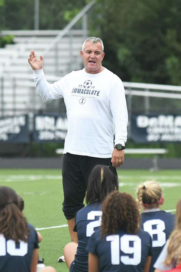 Immaculate girls soccer coach Nelson Mingachos during the Immaculate vs. Bethel girls soccer game at Immaculate in Danbury, Sept. 11, 2018. Photo: Krista Benson / The News-Times Freelance