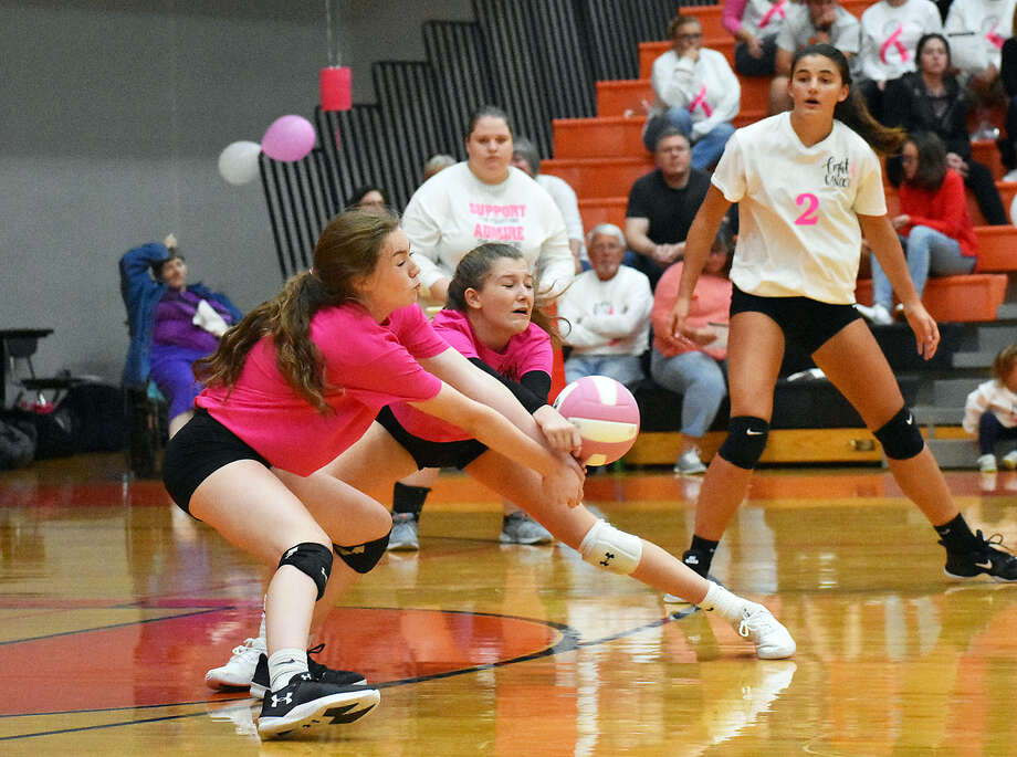 Edwardsville's Jillian Allen, left, and Kaitlyn Conway try to receive a serve during the first game against Cor Jesu on Wednesday inside the Lucco-Jackson Gymnasium. Photo: Matthew Kamp