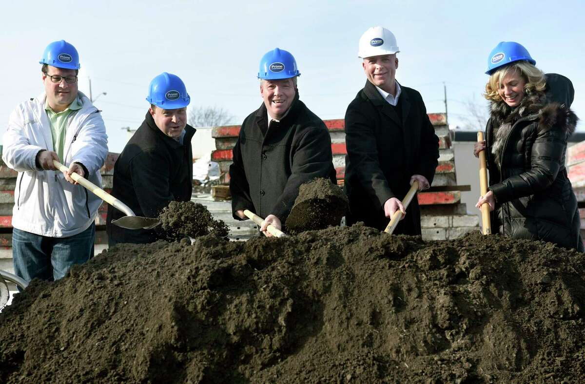 Officials join partners and subsidiaries of Prime Companies to break ground for the Hudson Square luxury apartment complex on Tuesday, Dec. 13, 2016, in Cohoes, N.Y. From left are Ralph Signoracci, chairman of Cohoes Industrial Development Agency, Jason Perillo, general manager and executive of Trinity Building and Construction Management, Mayor Shawn Morse, Todd Curley, partner with Prime Companies, and Laura Dehmer, vice president of the Capital Region Chamber. (Cindy Schultz / Times Union)