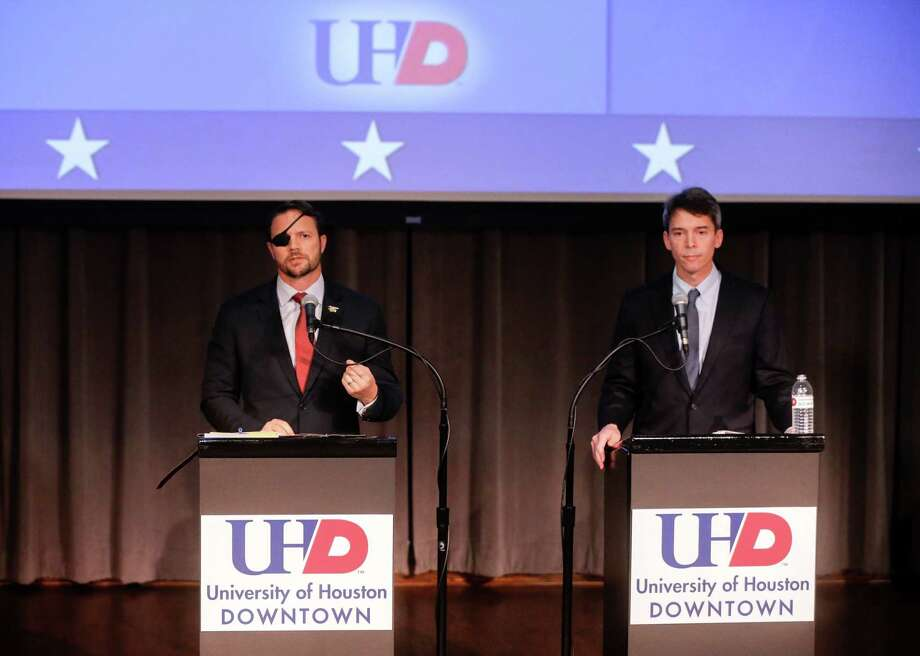 Republican Dan Crenshaw, left, and Democrat Todd Litton, right, candidates for Congressional District 2, are shown during a debate at the University of Houston-Downtown Wednesday, Sept. 26, 2018. Photo: Melissa Phillip, Houston Chronicle / Houston Chronicle