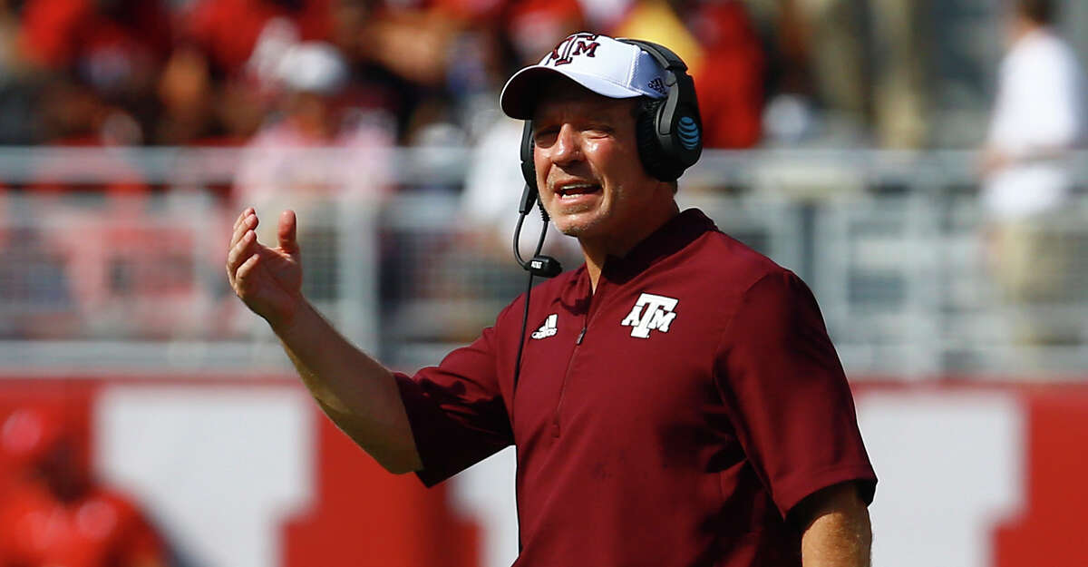 Texas A&M head coach Jimbo Fisher signals to players during the first half of an NCAA college football game against Alabama, Saturday, Sept. 22, 2018, in Tuscaloosa, Ala. (AP Photo/Butch Dill)