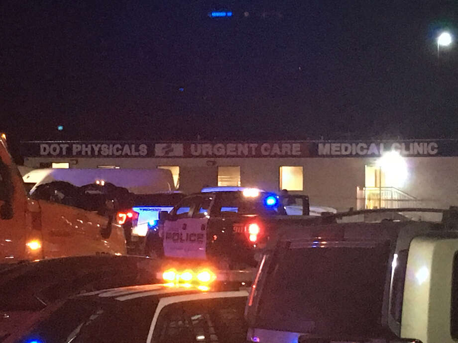 Law enforcement surround a medical clinic in the Flying J Travel Plaza on Wednesday night after shots were fired. A man in his mid-40s was detained. No injuries were reported. Photo: Danny Zaragoza/Laredo Morning Times