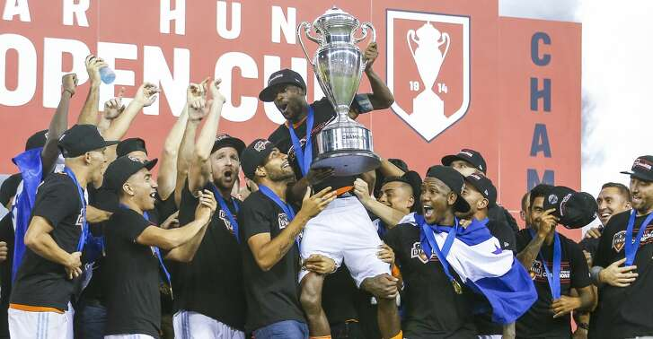 The Houston Dynamo hoist midfielder DaMarcus Beasley (7) into the air as they celebrate after beating the Philadelphia Union 3-0 to win the 2018 Lamar Hunt U.S. Open Cup Final at BBVA Compass Stadium Wednesday Sept. 26, 2018 in Houston.