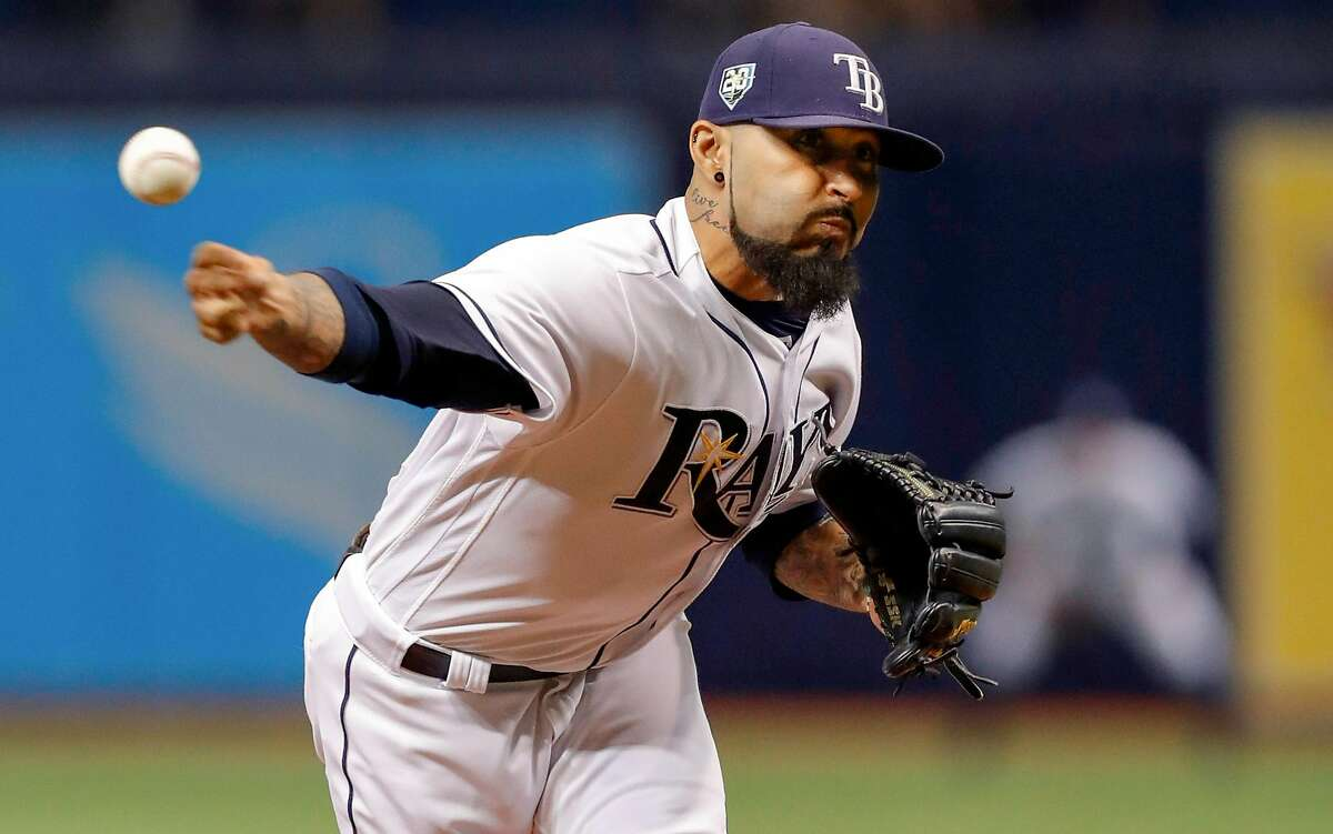 ST. PETERSBURG, FL - SEPTEMBER 26: Sergio Romo #54 of the Tampa Bay Rays throws in the eighth inning of a baseball game against the New York Yankees at Tropicana Field on September 26, 2018 in St. Petersburg, Florida. (Photo by Mike Carlson/Getty Images)
