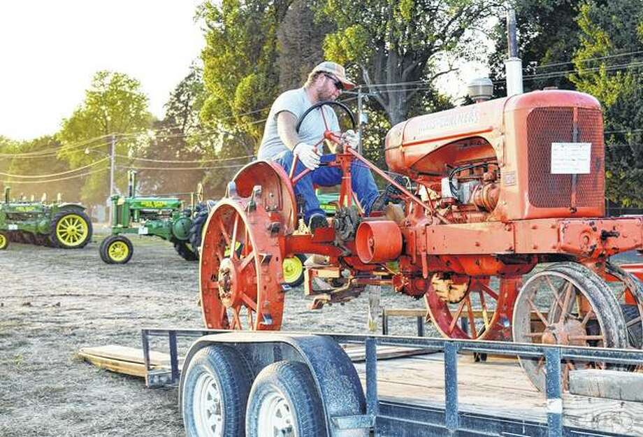 Chris Burbridge of Pittsfield loads his antique tractor at the end of the 2017 Prairie Land Heritage Museum Fall Festival and Steam Show. The steam show, in its 49th year, will feature a display of Oliver farm equipment when it opens Friday at the museum. Photo: Audrey Clayton | Journal-Courier