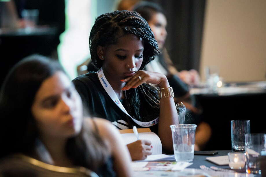 Andronica Klaas, a Bank of America employee takes notes about the message and presentation given by SMASH Academy alumnae, Wednesday, Sept. 26, 2018, in Houston. SMASH is a STEM-intensive college preparatory program for underrepresented high school students of color free of cost. Photo: Marie D. De Jesús, Staff Photographer / © 2018 Houston Chronicle