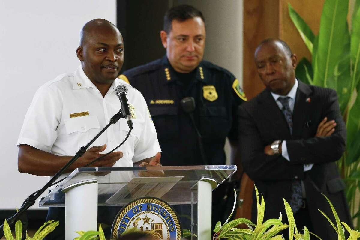 Houston Fire Department executive assistant chief Rodney West, left, speaks at a town hall with Houston mayor Sylvester Turner, right, and Houston Police chief Art Acevedo as they collectively attempt to convince the public to vote against a pay parity ballot measured for the Houston Fire Department Wednesday Sept. 19, 2018 in Houston.